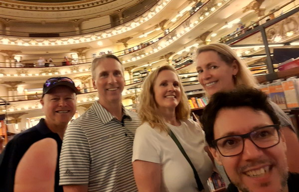 Private tour guide Buenos Aires Pablo Piera with happy Customers at famous bookstore El Ateneo